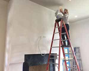 Paper Moon Painting painter Edgar applying interior plaster finish