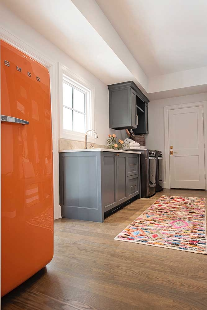 Laundry room with orange vintage fridge and painted cabinets in BM CSP-120 Burnt Ember by Paper Moon Painting, Austin cabinet painter