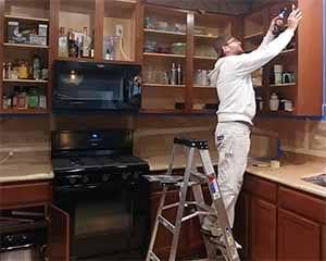Beau, Austin kitchen cabinet refinisher in action