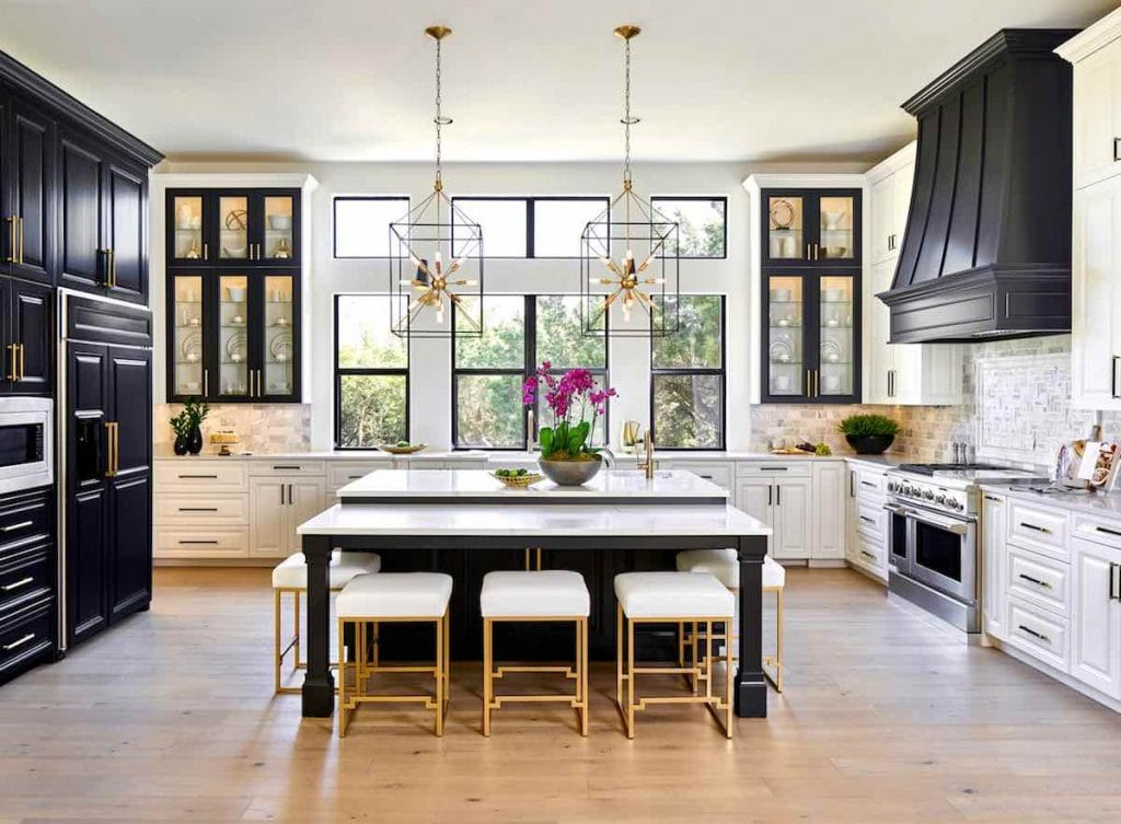 Painted kitchen cabinets in Sherwin Williams SW 7005 Pure White, black island in Benjamin Moore BM 2133-10 Onyx, Paper Moon Painting, cabinet painters
