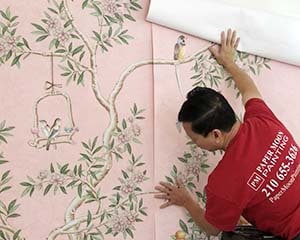 Pink Gracie hand-painted wallpaper installation by Paper Moon Painting wallpaper hanger, Austin