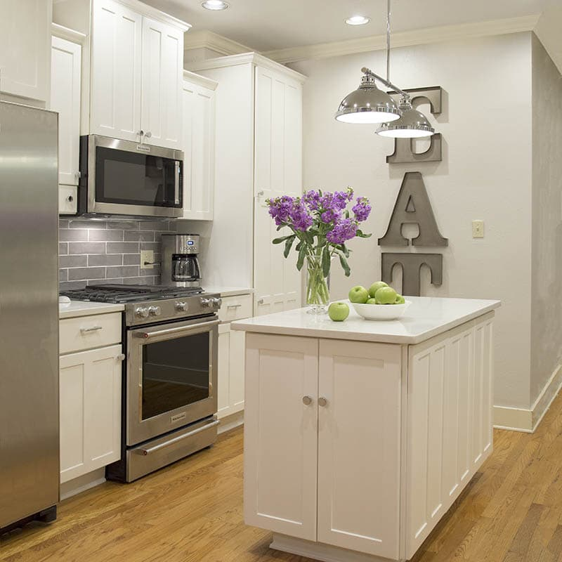 White painted cabinets in Benjamin Moore BM OC-117 Simply White, Austin cabinet painting