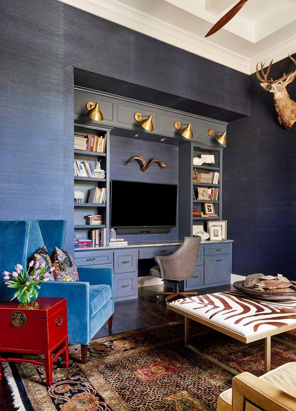 Blue grasscloth wallpaper installation in home office, desk area