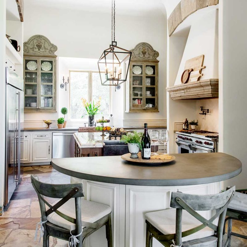 Hacienda style kitchen walls and cabinets painted white