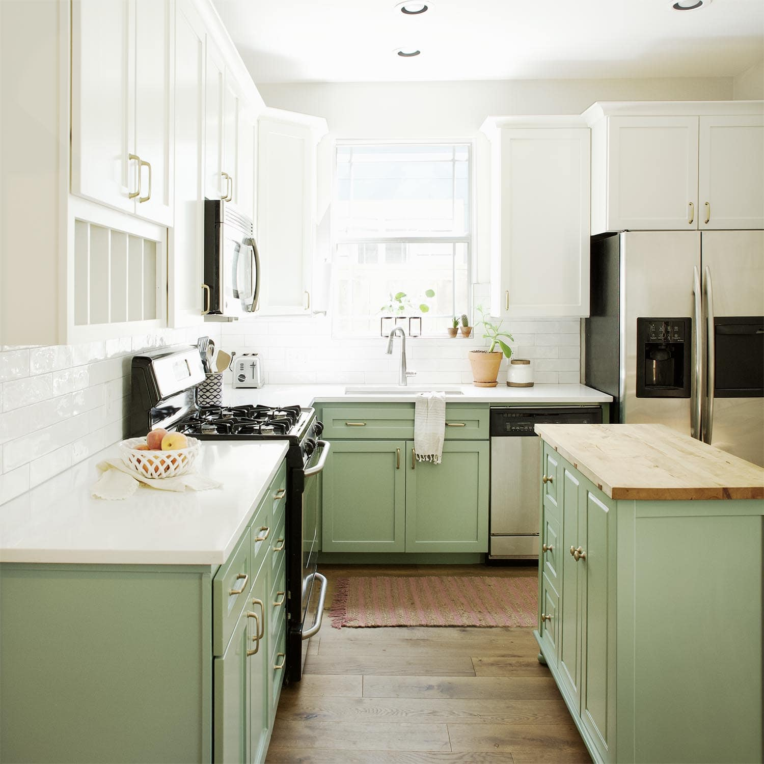 Green and white kitchen cabinets painted in BM Greenwich Village and SW Alabaster, Paper Moon Painting contractor, Austin