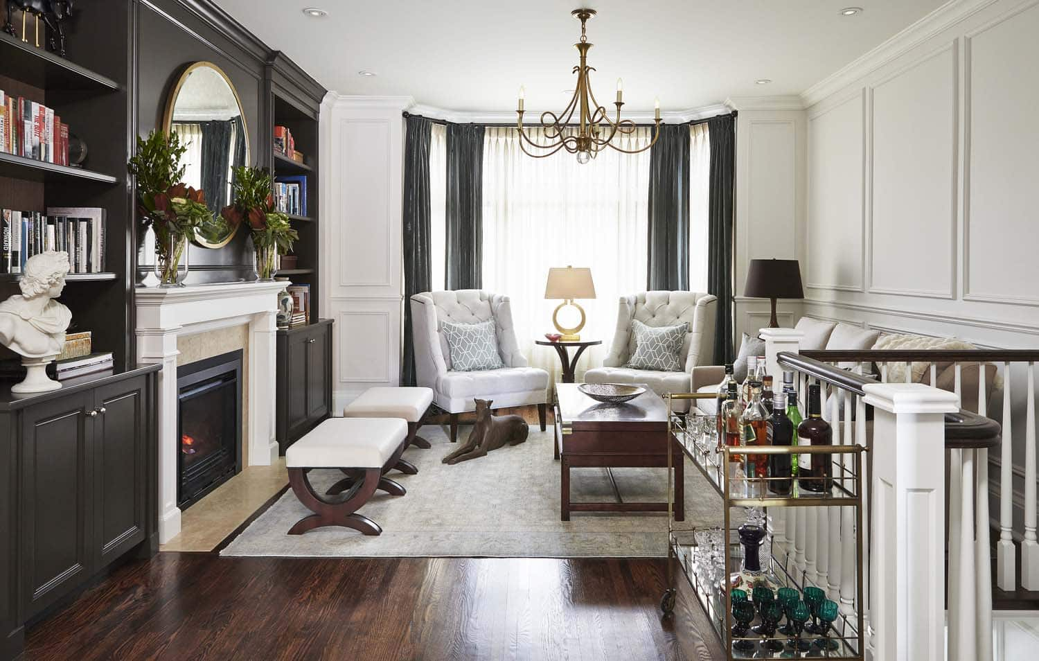 Image of living area with built in cabinets and fireplace, designed by Laura Stein Interiors.