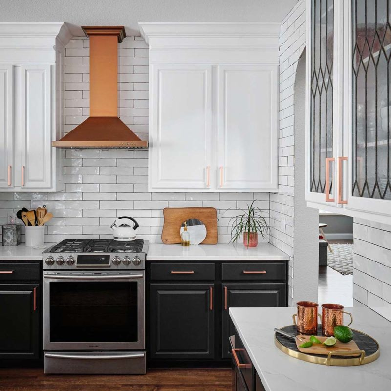 Black and white traditional kitchen, lower cabinets painted in Benjamin Moore Onyx, uppers in custom white, Paper Moon Painting, Austin