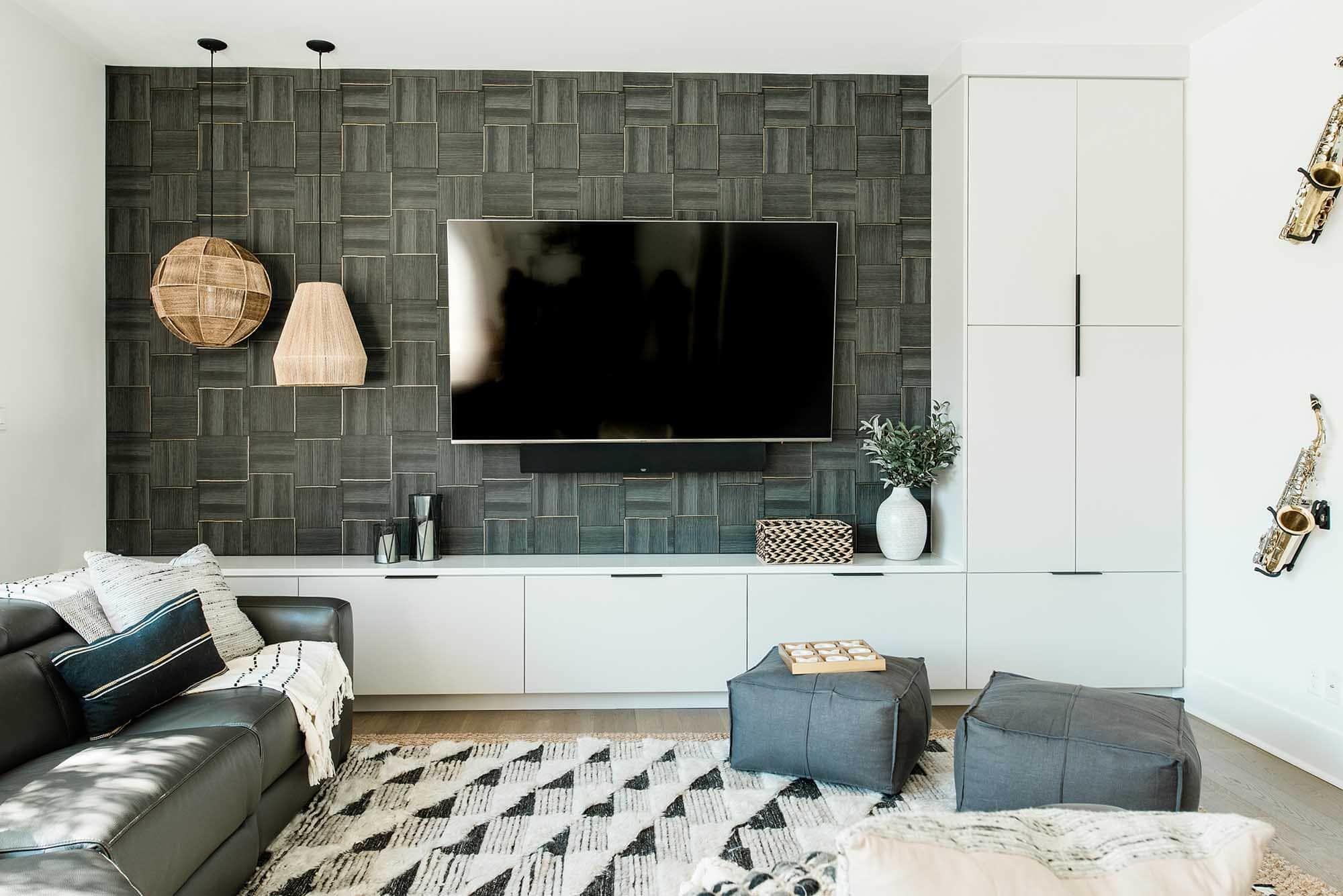 Wallpaper feature wall, dark grey graphic pattern, TV room, Alamo Heights wallpaper hanger
