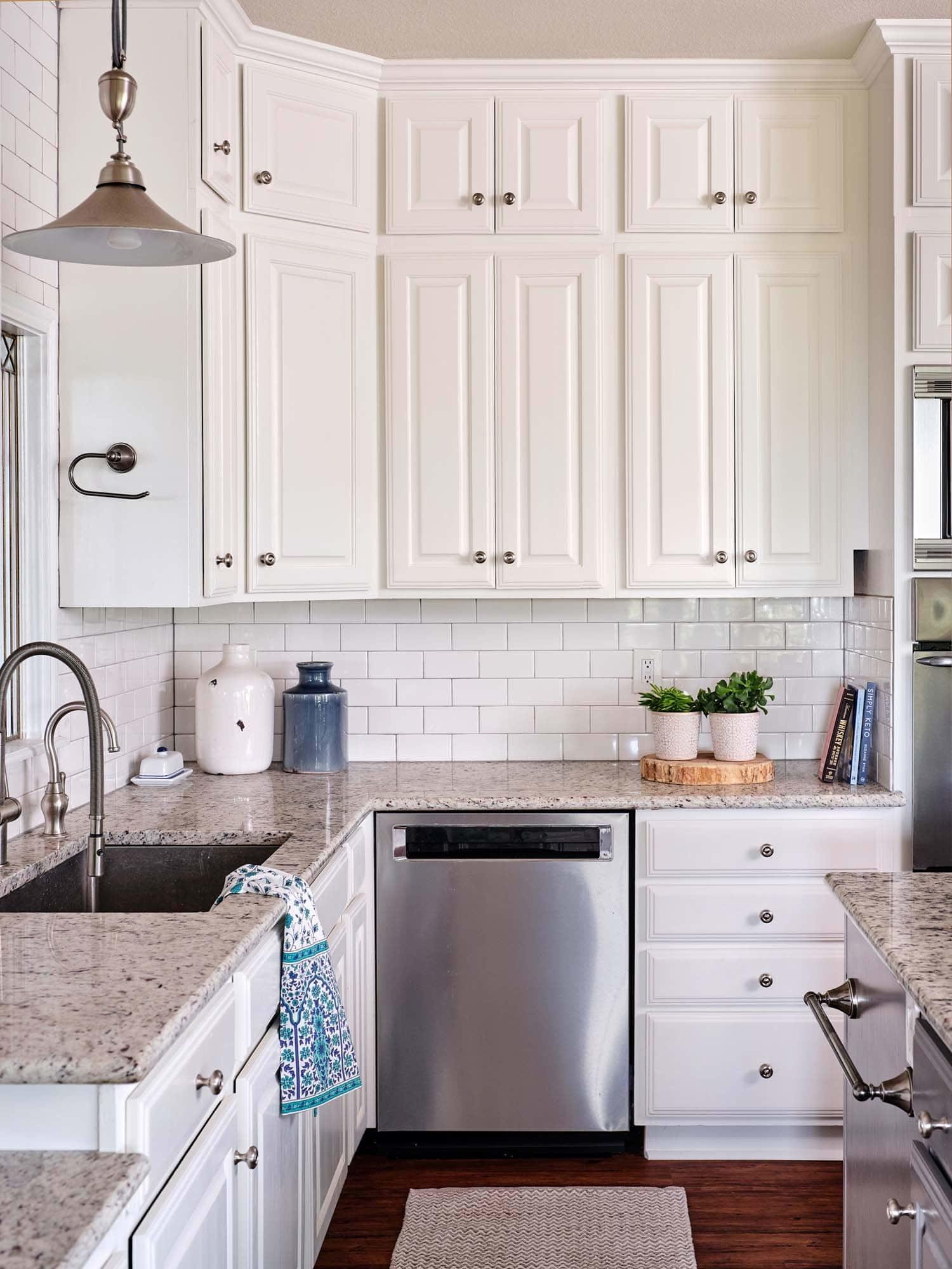 Kitchen cabinets painted in Benjamin Moore Cloud White and Tweed Coat, Paper Moon Painting San Antonio TX