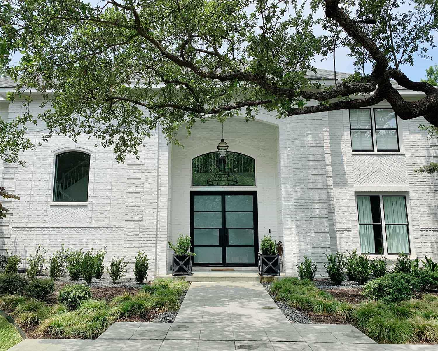 White painted brick home exterior in Sherwin Williams 7005 Pure White by Paper Moon Painting, Alamo Heights TX