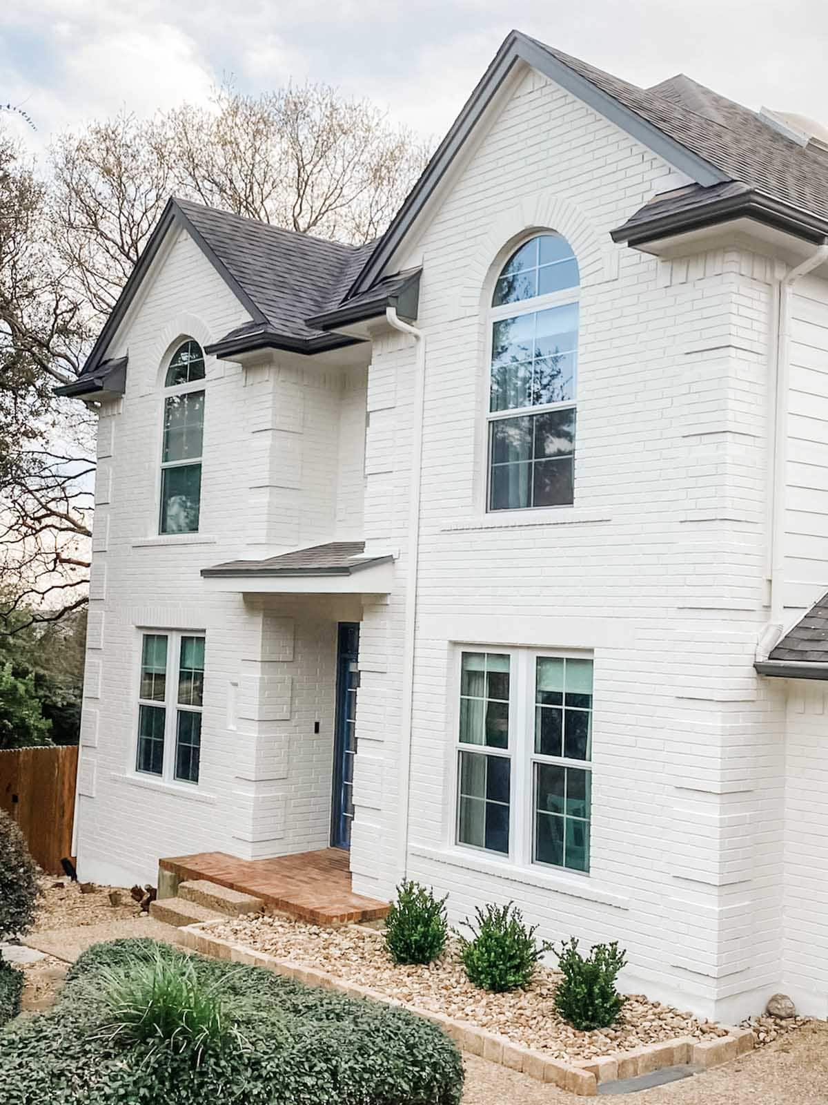 White painted brick exterior in Sherwin Williams Cotton White, Austin Round Rock, TX