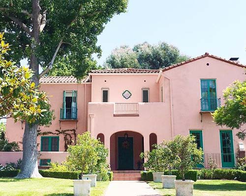 pink exterior stucco house, better exterior color