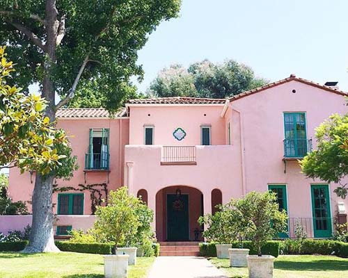 pink exterior stucco house, too bright